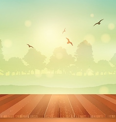 Wooden table looking out to sunny landscape vector image