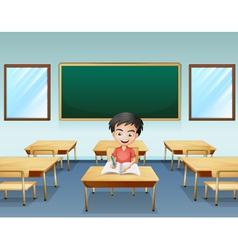 A boy inside classroom with an empty board vector