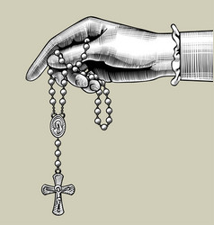 Womans hand with prayer beads vector