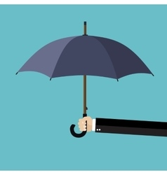 Businessman hand holding an umbrella vector image