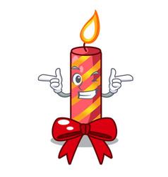 Wink cartoon christmas candles on a table vector