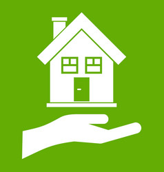 hand holding house icon green vector image