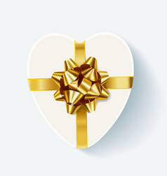 white heart shaped gift box with golden bow vector image