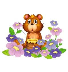 A bear holding a honey in the flower garden vector image vector image