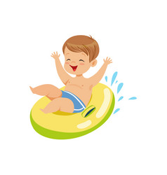 cute boy having fun floating with lifebuoy vector image vector image