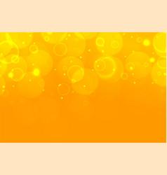 Yellow shimmering bokeh sparkles beautiful vector