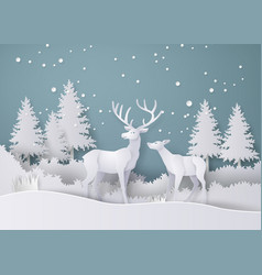 deer in forest with snow in the winter season vector image