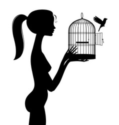 Silhouette naked girl releases a bird from a vector
