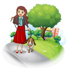 A woman with her dog at the road vector
