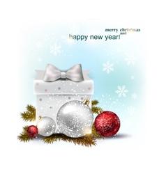 Beautiful Christmas balls and gift on snow Xmas vector image