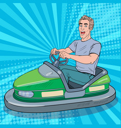Pop art excited man riding bumber car at fun fair vector