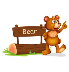 A bear standing beside a wooden board vector