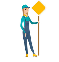 Caucasian road worker showing road sign vector