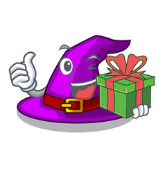 With gift witch hat isolated with mascot vector