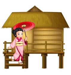 Japanese girl at the bamboo hut vector