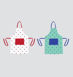 two kitchen aprons with polka dot patterns vector image