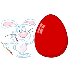 happy rabbit painting red easter egg vector image vector image