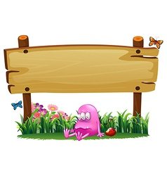 A poisoned pink monster under the empty wooden vector image vector image