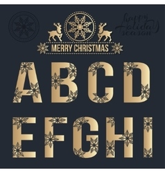 Set of Christmas golden alphabet with snowflakes vector image