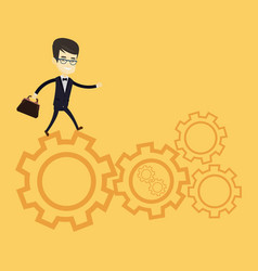 business man running on cogwheels vector image