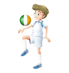 A football player using the ball with the flag of vector image vector image