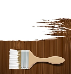 Paintbrush with white paint on a wooden surface vector image