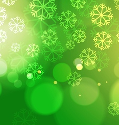Abstract Bokeh Lights with Snowflakes on Green vector image