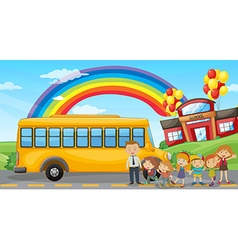 Students and school bus at school vector image
