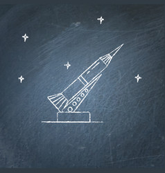 rocket and launch pad icon on chalkboard vector image