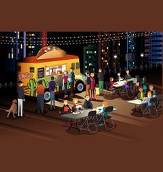 People eating taco at taco truck at night vector