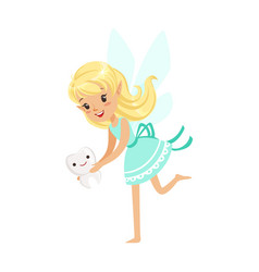 beautiful sweet blonde tooth fairy girl holding vector image