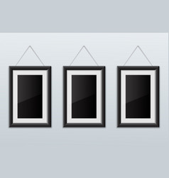 three black empty picture frames vector image