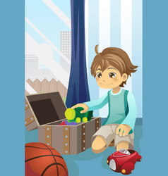 Boy cleaning up his toys vector