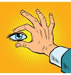 Retro hand holding eyes vector