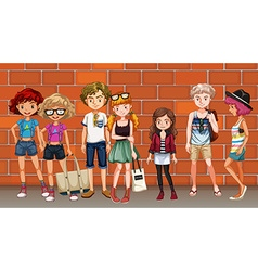 Hipster boys and girls hanging out on the street vector