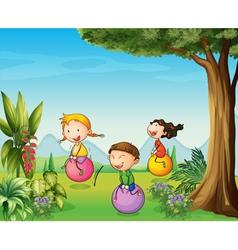 Three kids having fun with a bouncing ball vector image vector image