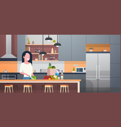 woman cooking salad in modern kitchen room vector image