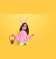 woman wearing bunny ears cute girl holding basket vector image