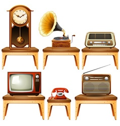 Retro antiques on wooden table vector image
