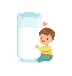 cute little boy hugging giant milk glass healthy vector image