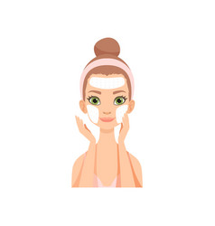 Attractive young woman applying cleansing mask vector