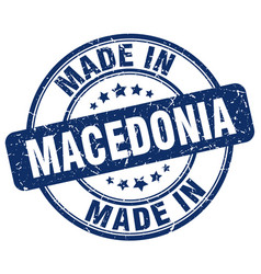 made in macedonia blue grunge round stamp vector image vector image