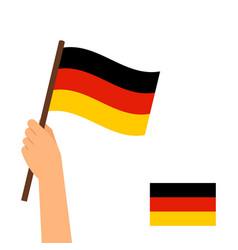 Human hand holding flag germany vector