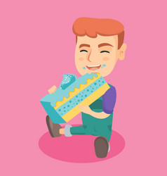 little caucasian happy boy eating a piece of cake vector image