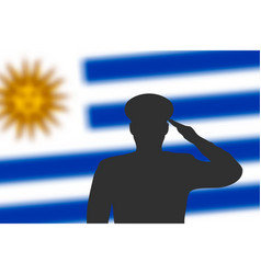 solder silhouette on blur background with uruguay vector image