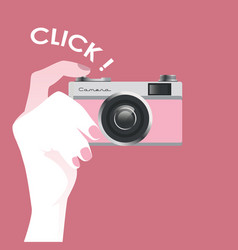 Cute vintage style pink photo camera held by a vector