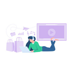 Young woman lying on floor with laptop vector