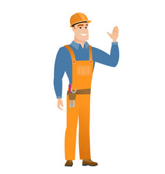 young caucasian builder waving his hand vector image vector image
