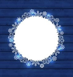 Christmas round frame made in snowflakes on blue vector image