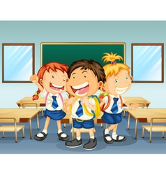 Three children smiling inside the classroom vector